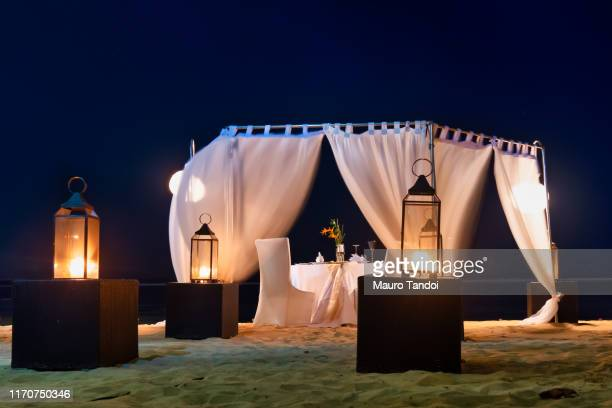 romantic candlelight table in bali, indonesia - mauro tandoi stock photos and pictures
