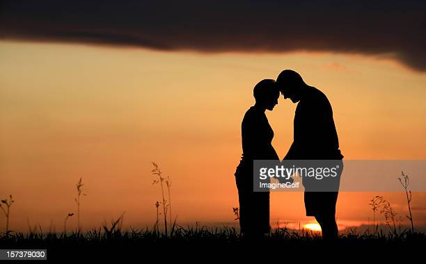 romantic caucasian couple at sunset - community engagement stock pictures, royalty-free photos & images