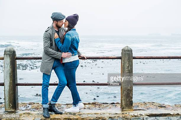 Romantic couple about to kiss at seaside