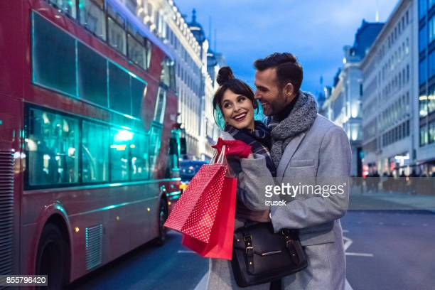 romantic couple after shopping in london at dusk, autumn season - oxford street london stock pictures, royalty-free photos & images