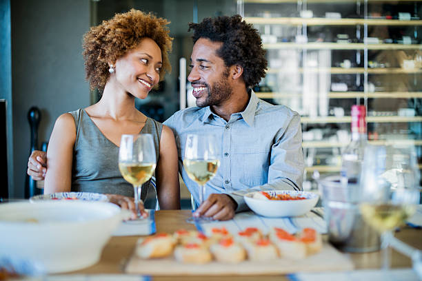 romantic couple at a dinner party - couples romance stock pictures, royalty-free photos & images