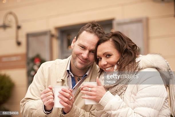 Romantic Couple Drinking Tea Outdoors