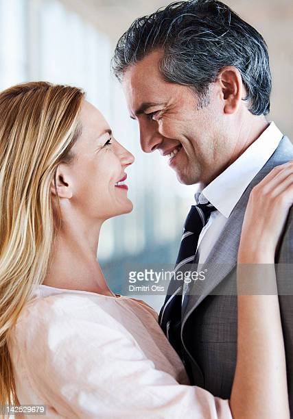 Romantic couple embracing, smiling, close-up