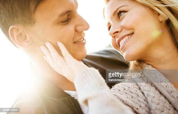 romantic couple enjoying the sunset embracing
