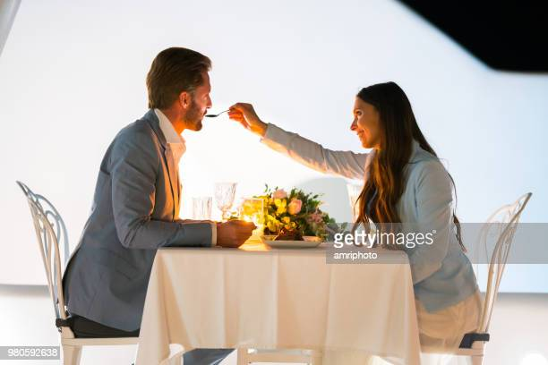 romantic couple enjyoing dinner for two