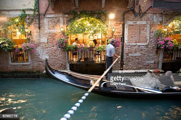 romantic couple having dinner by venian restuarant
