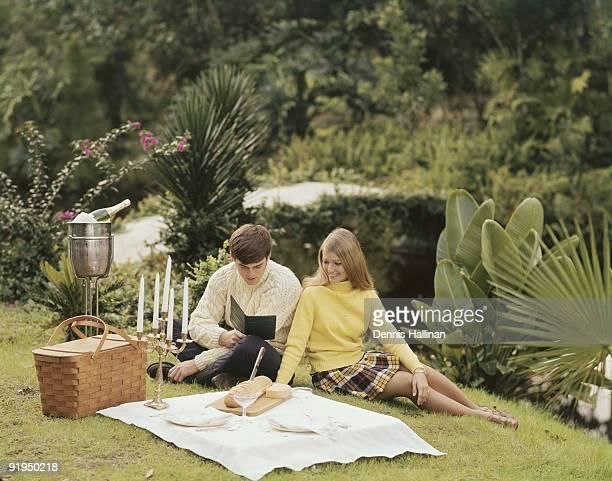 Romantic couple having luxury picnic in garden