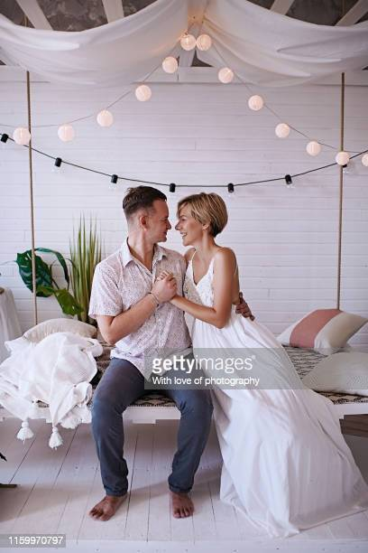 romantic couple in love, hugging and kissing, happy loving couple, male and female young adult, 30-39 years old - 30 39 years stockfoto's en -beelden