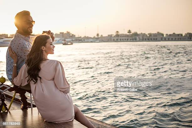 Romantic couple looking out from boat at Dubai marina, United Arab Emirates