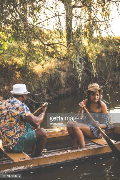 romantic couple on a rowboat - mexican picnic stock pictures, royalty-free photos & images