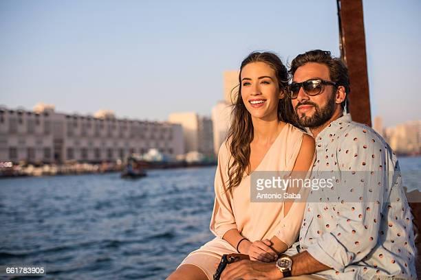Romantic couple on boat at Dubai marina, United Arab Emirates
