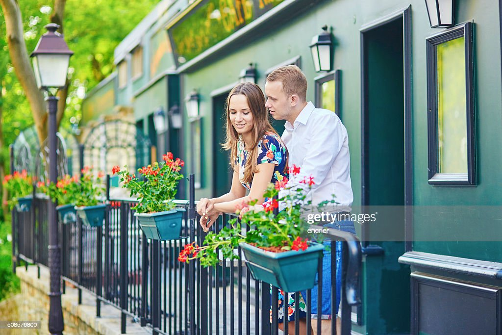 Romantic couple on the balcony decorated with flowers : Stock Photo