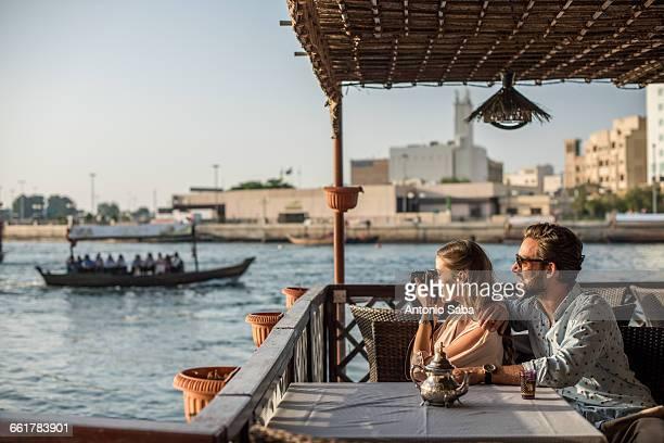 Romantic couple photographing from Dubai marina cafe, United Arab Emirates