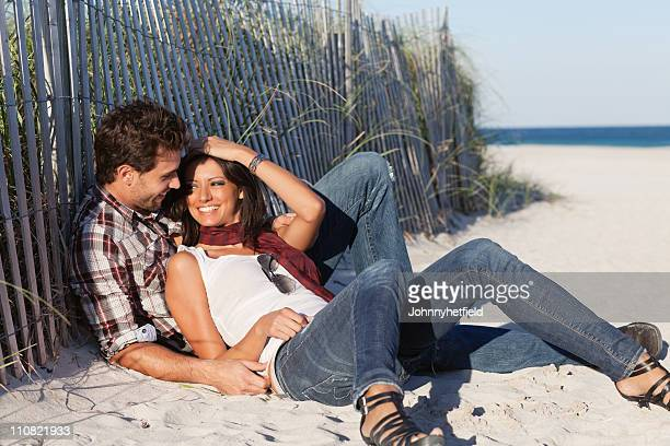 Romantic couple relaxing at beach