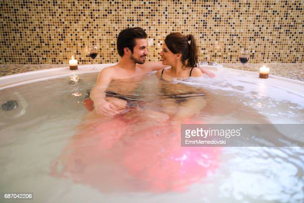 Romantic couple relaxing in jacuzzi at health spa.