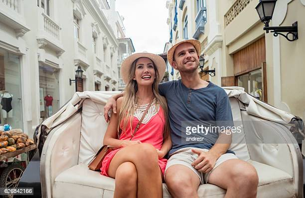 Romantic couple riding on a carriage while traveling