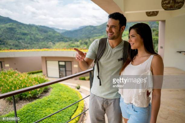 Romantic couple traveling and looking at the view of their hotel