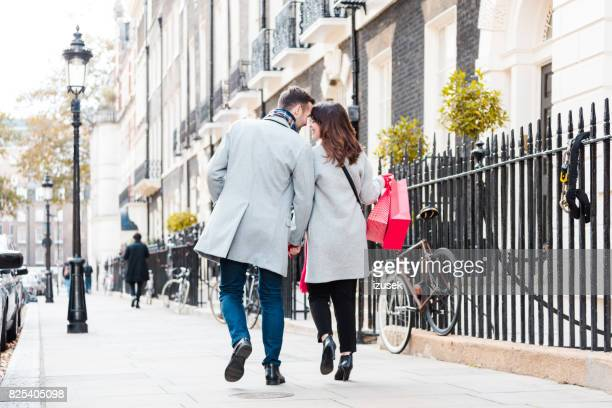 Romantic couple walking on the sidewalk