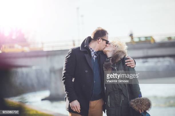 romantic couple with dog - couple tongue kissing stock photos and pictures