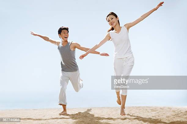 Romantic couples running on the beach