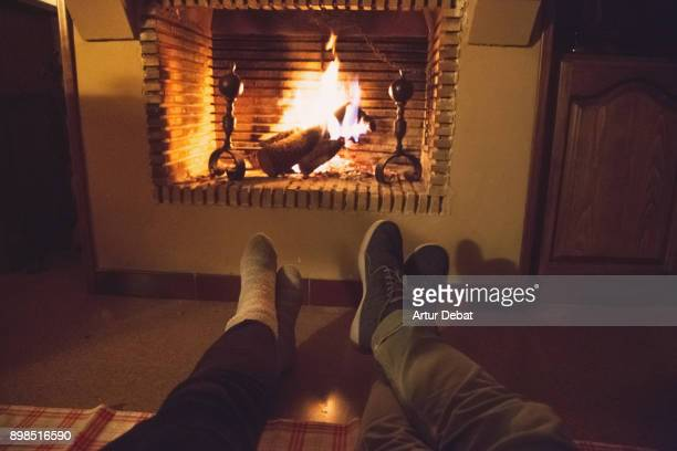 romantic date of a couple in love in the countryside with old house and fireplace during winter in the catalan pyrenees spending the christmas time vacations. - country christmas stockfoto's en -beelden