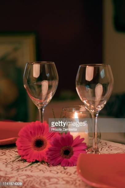 romantic dining table with two wine glasses - romantic dinner stock pictures, royalty-free photos & images