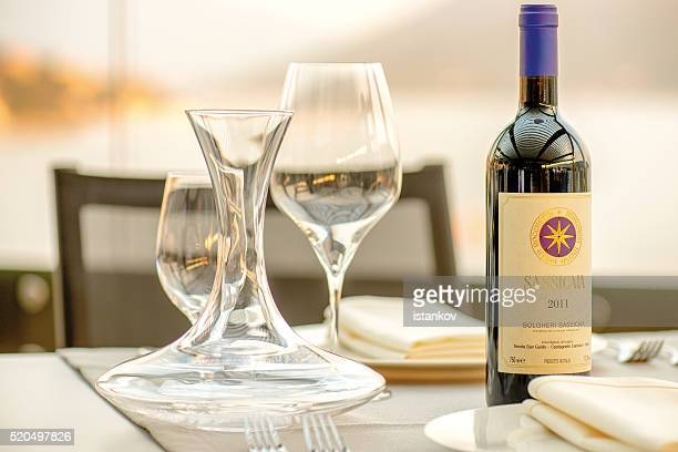 Romantic dinner at the sunset. Sassicaia wine served