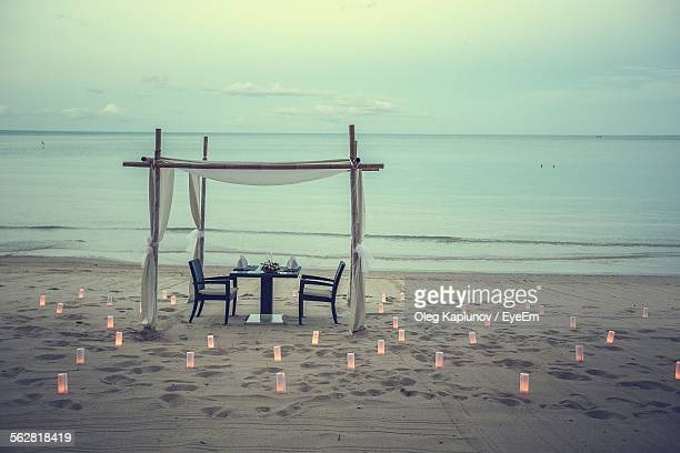 romantic dinner on beach - romantic stock pictures, royalty-free photos & images
