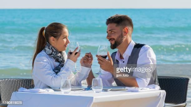 romantic dinner beach couple honeymoon drinking