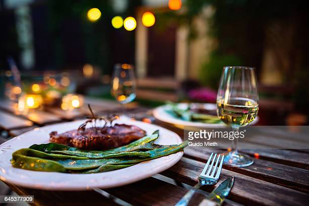 romantic dinner outdoor. - esstisch stock-fotos und bilder