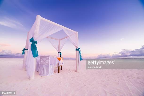 Romantic dinner setup at the beach
