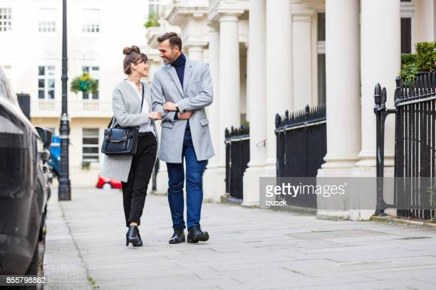 romantic elegant couple walking in the city street in london - bloomsbury london stock photos and pictures