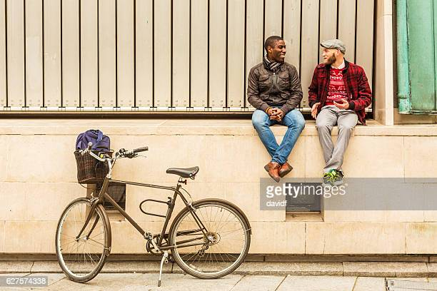 Romantic Gay Hipster Couple Sitting Together Talking
