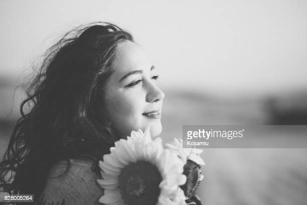Romantic Girl Embracing Sunflowers
