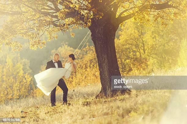 romantic grooms on swing