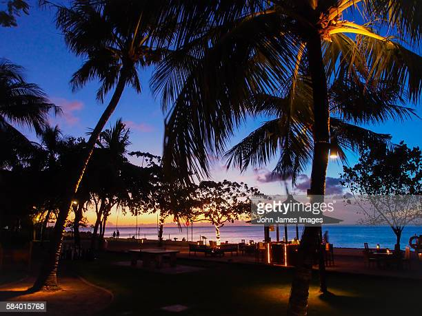 Romantic holiday resort sunset with palm trees