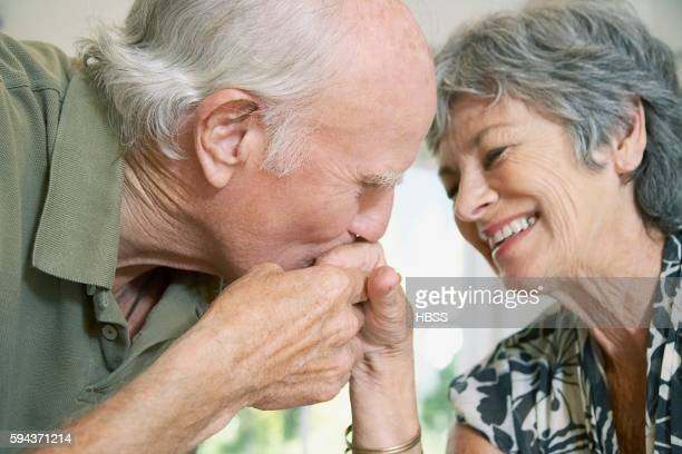 Romantic husband kissing his wife's hand