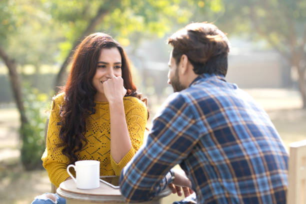 romantic indian couple having coffee at park - couples romance stock pictures, royalty-free photos & images