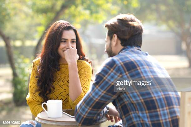 romantic indian couple having coffee at park - love emotion stock pictures, royalty-free photos & images