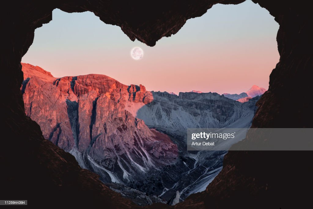 Romantic landscape with heart shape of the Alps mountains with full moon. : Stock Photo