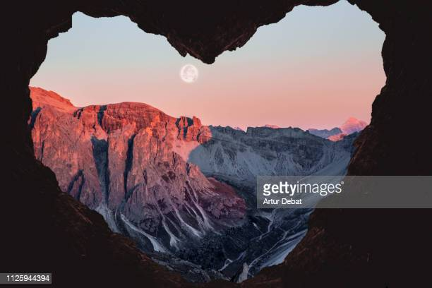 romantic landscape with heart shape of the alps mountains with full moon. - canyon foto e immagini stock