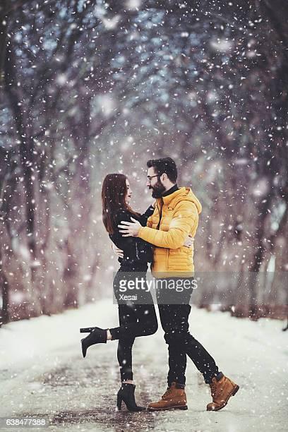 Romantic Lovely Couple Having Fun In A Snowy Park