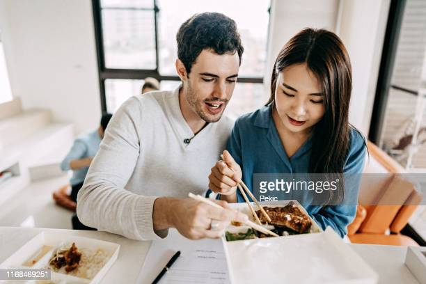 romantic lunch and freelance work - chinese food stock pictures, royalty-free photos & images