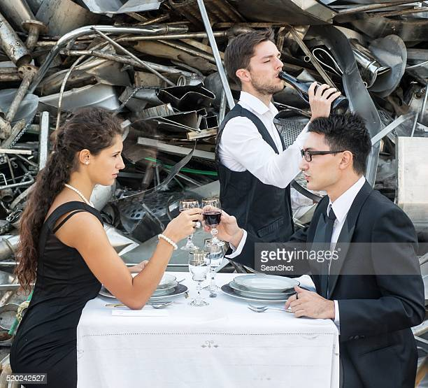 Romantic Lunch in Landfill. Waiter with Bad Manners