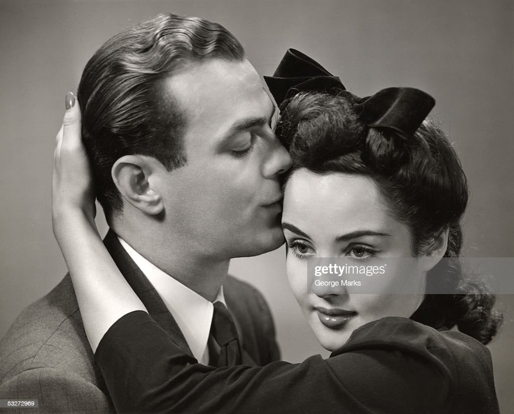 Romantic Man Kisses Woman On Forehead High-Res Stock Photo