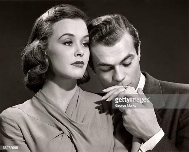 Romantic man kissing woman's hand