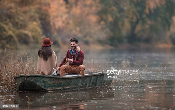 Romantic man taking his girlfriend on a boat ride.
