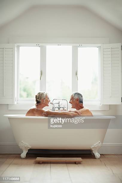Romantic, mature couple having fun in a bathtub
