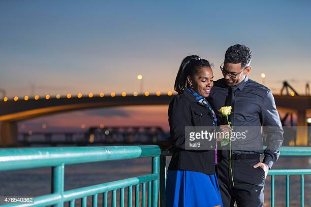 romantic mature couple on waterfront - kali rose stock pictures, royalty-free photos & images