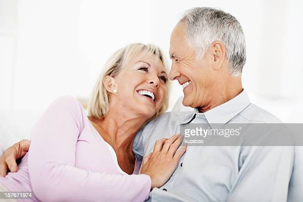 Romantic mature couple smiling while looking at each other